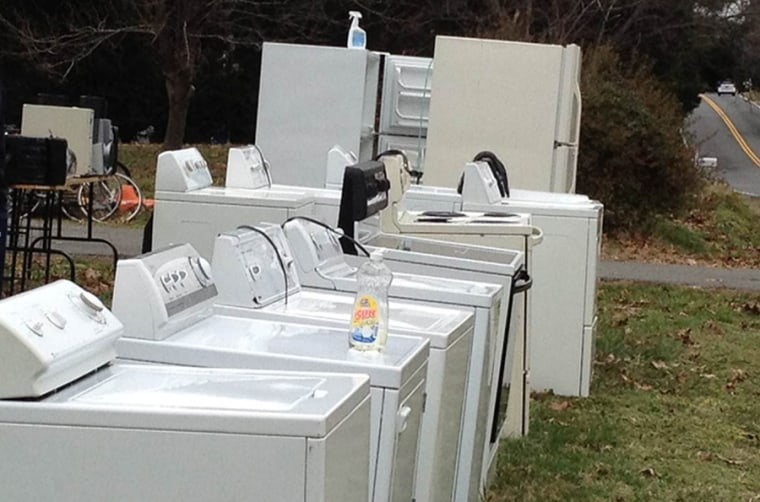 A slew of appliances sitting on a lawn are part of a garage sale that some municipalities argue have gotten out of hand.