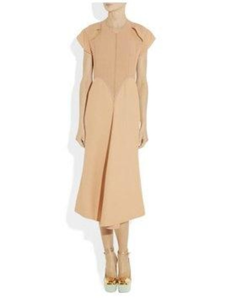 The Calvin Klein apricot silk-crepe dress features a cut-out design and costs $5,000.