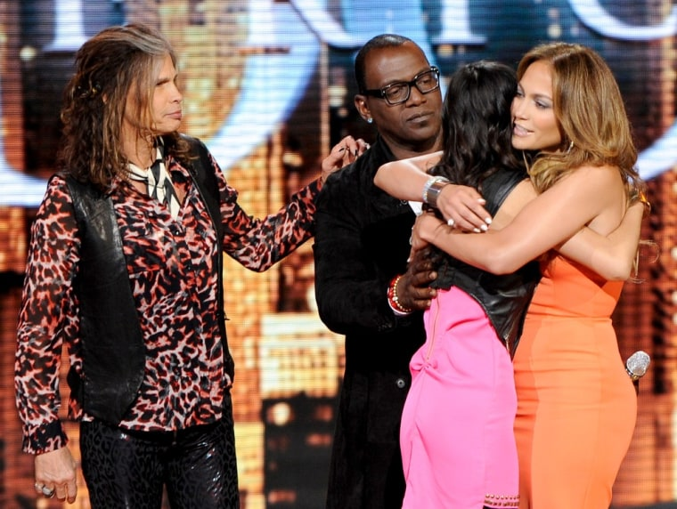 ""\""""American Idol"""" judges Steven Tyler, Randy Jackson and Jennifer Lopez stormed the stage on April 12 to save contestant Jessica Sanchez from elimination.""760|572|?|en|2|f7327d803af5c2248e9d6241382d67a1|False|UNSURE|0.33551397919654846
