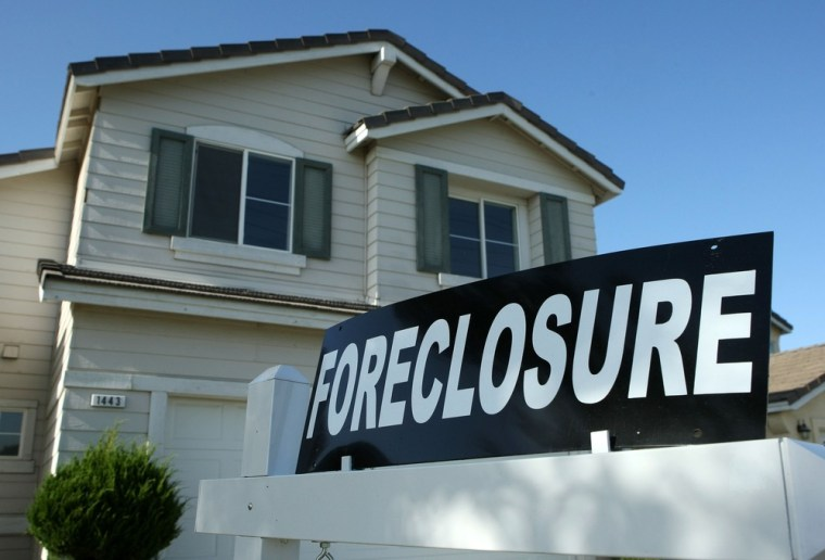 A foreclosure sign sits in front of a home. Errors are being made in the process that lead lenders to foreclose on homes.