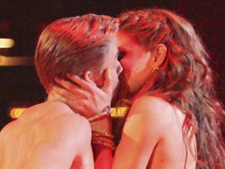 """Pro hoofer Derek Hough and TV host Maria Menounos shared a big smooch during their \""""DWTS\"""" performance on April 16."""