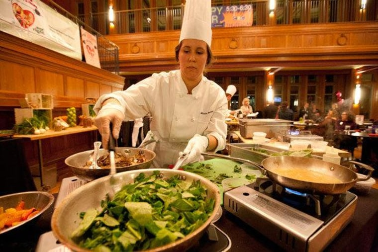 A chef prepares a meal at Washington University in St. Louis during a cooking competition.