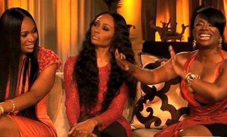 """Cynthia Bailey was caught in the middle as Marlo Hampton (left) and Kandi Burruss (right) fought on the final installment of \""""The Real Housewives of Atlanta\"""" reunion special."""