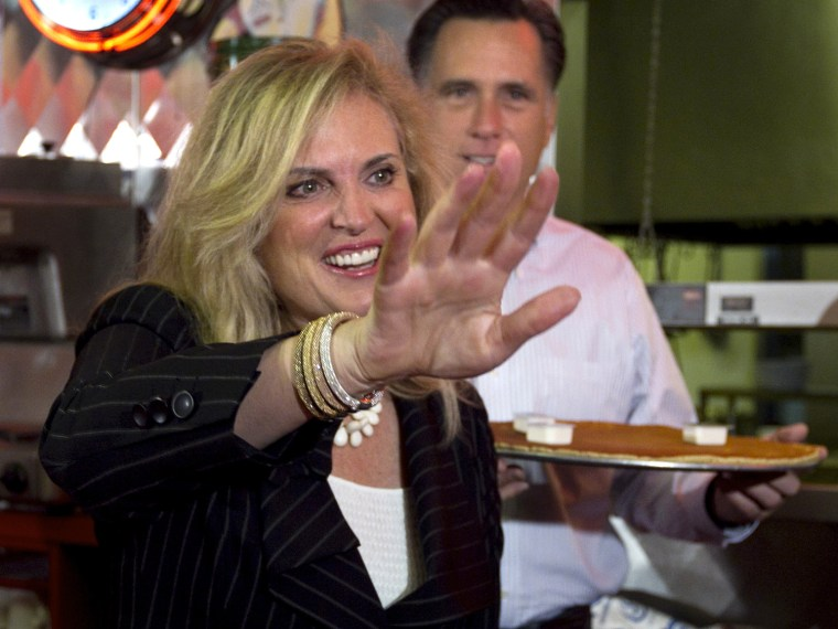 Ann and Mitt, holding flapjack, at a campaign stop in Springfield, Ill. on March 19.