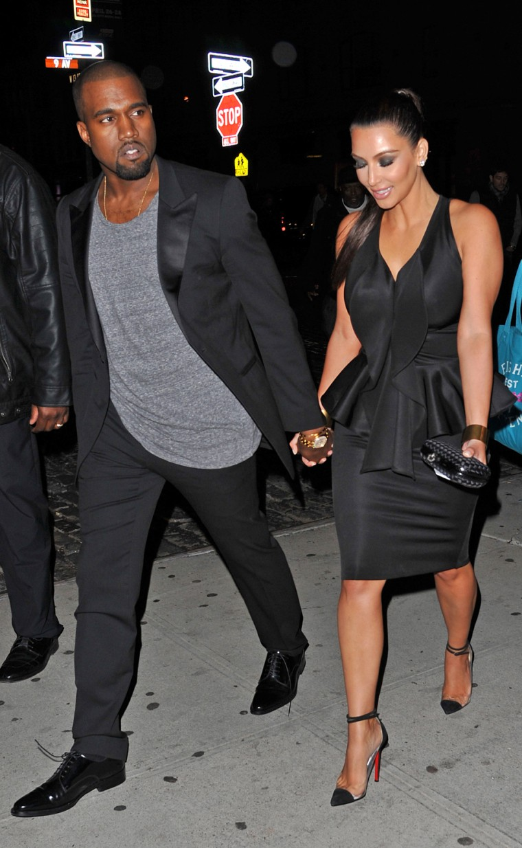 Kim Kardashian and Kanye West hold hands while leaving Ryu, Scott Disick's new Japanese restaurant in New York.