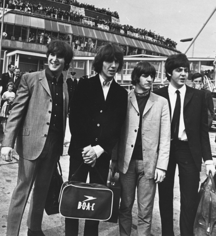 The Beatles, preparing to leave London for their American tour in 1965.