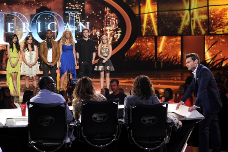 "\""American Idol\"" contestants, from left, Jessica Sanchez, Skylar Laine, Joshua Ledet, Elise Testone, Phillip Phillips and Hollie Cavanagh stand onstage as host Ryan Seacrest talks to the judges Wednesday night."