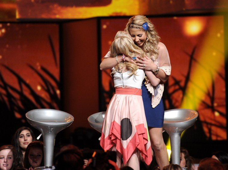 """The bottom two contestants, Hollie Cavanagh, left, and Elise Testone hug onstage during Thursday's \""""American Idol\"""" elmination show."""