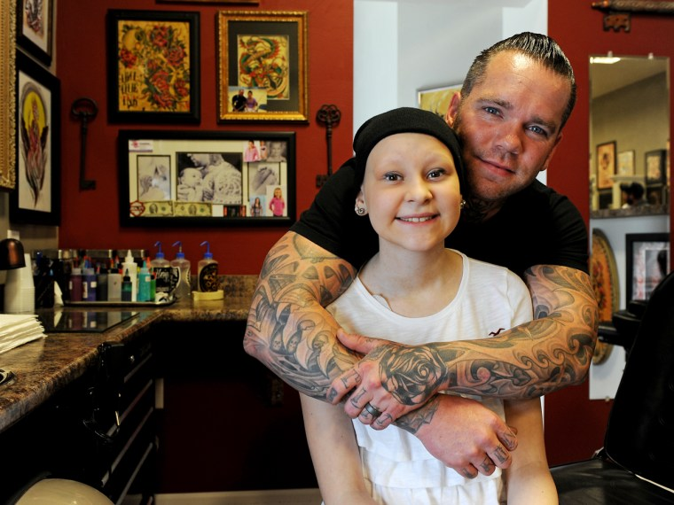 Not your average fund-raiser: Nick Christofano, owner of Unique Ink Tattoo, held a charity tattoo event at his shop to help with medical costs for his daughter Shelby Lee Sisco, 15, who was diagnosed with leukemia.