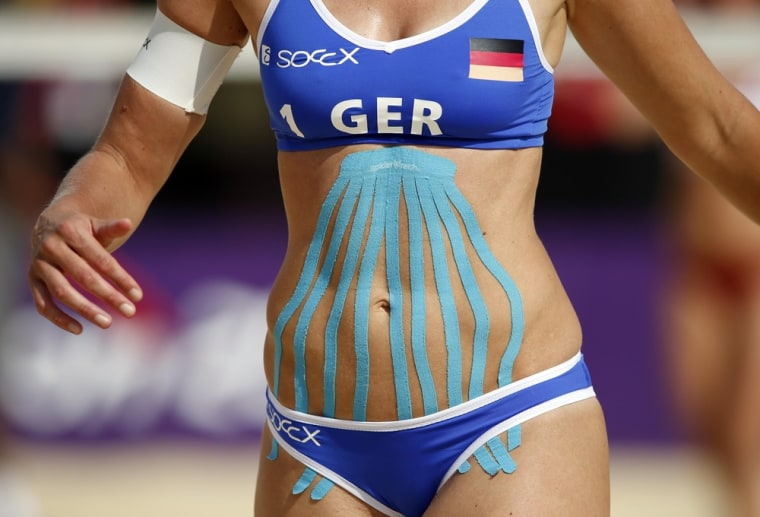 Germany's Katrin Holtwick sports kinesio tape during the women's beach volleyball preliminary match against Czech Republic during the London 2012 Olympic Games on July 28.