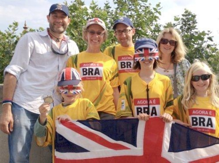 British Olympic fans look from London 2012 to Rio 2016: Richard Pope (far left) and his wife Penny (far right) at Casa Brasil in London on Sunday with Penny's brother Jim (second from right) and his wife Sue (second from left) with their children Ralph, 6, (front left) and Daisy, 8, (front, right) and their friend Kit Simmons, 10 (front center).