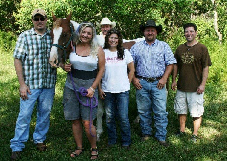 Michelle Pool is pictured handling her horse Opie with the support of friends and family. Shown left to right, front row, are Jeff Wilson, Michelle Pool, Deanna Bordelon, Chance Ward and Brent Bordelon. Standing behind the horse is Pool's father, Andrew Pool.