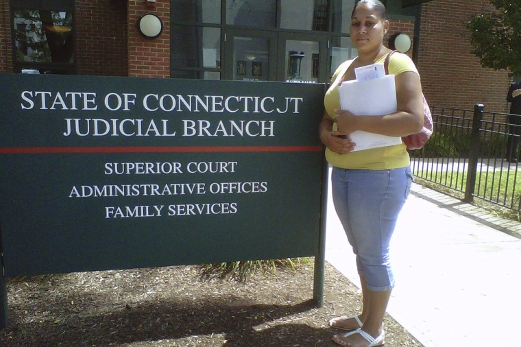 In this Wednesday, Aug. 8, 2012 photo, Jennifer Garcia, 23, of Hartford, Conn., stands in front of Hartford Family Court after a child visitation hearing.