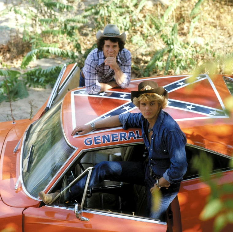 """Tom Wopat and John Schneider flew around the hills of Hazzard County in the General Lee on \""""The Dukes of Hazzard.\"""" Now the car's Confederate flag has become an issue."""
