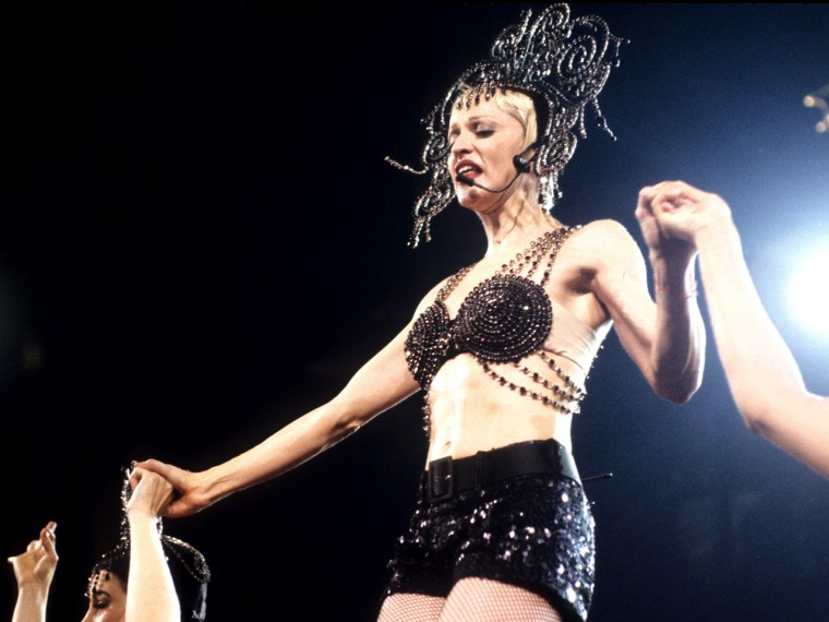 Madonna, wearing a bold creation by Jean Paul Gaultier, performs in New York City in 1993. This outfit was not sold at the auction, but represents the style Madonna repeatedly wore at her concerts.