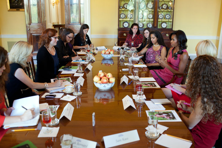 First lady Michelle Obama holds a roundtable discussion on the Let's Move initiative in the Old Family Dining Room of the White House. That's TODAY.com on the end, very intently taking notes.