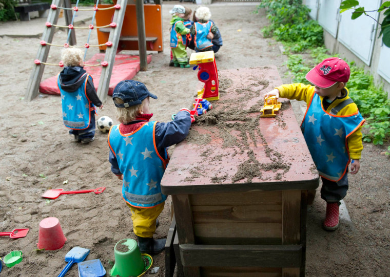 """Children play in the garden of """"Egalia"""", a Swedish gender-free preschool in Stockholm, Sweden, where staff avoid using words like """"him"""" or """"her"""" and address the children as """"friends"""" rather than girls and boys."""