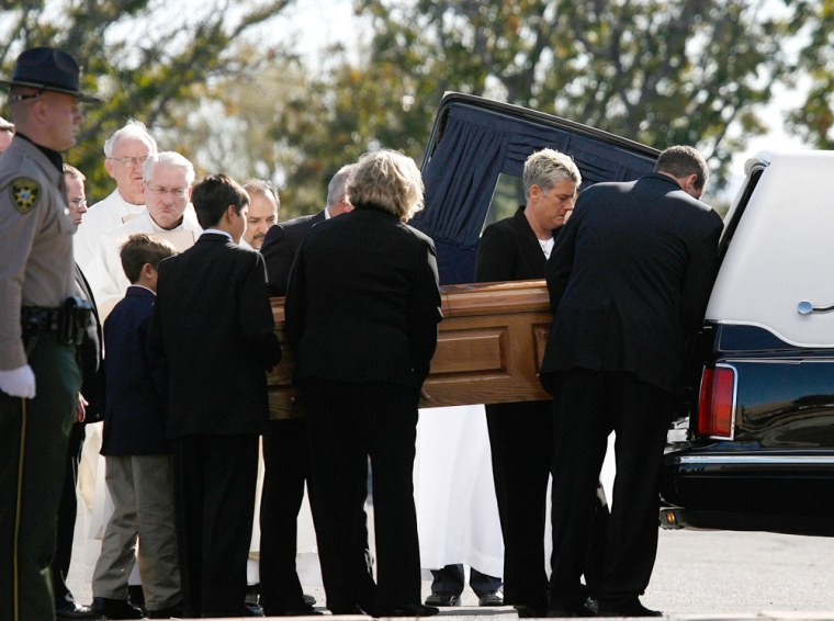 Pall bearers load the casket into a hearse outside St. Elizabeth Ann Seton Church after the funeral of 9-year-old Christina Green in Tucson, Arizona January 13, 2011.