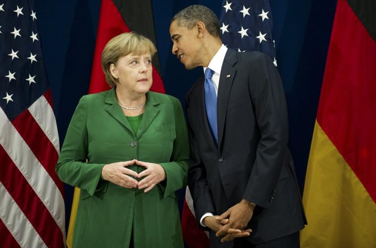 U.S. President Barack Obama, right, talks with German Chancellor Angela Merkel.