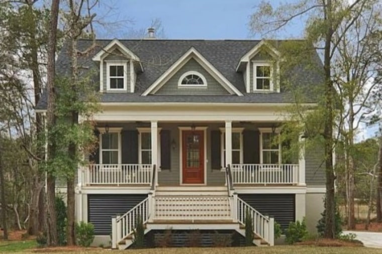 The use of different body and trim colors gives this Charleston, S.C., home a more traditional look.