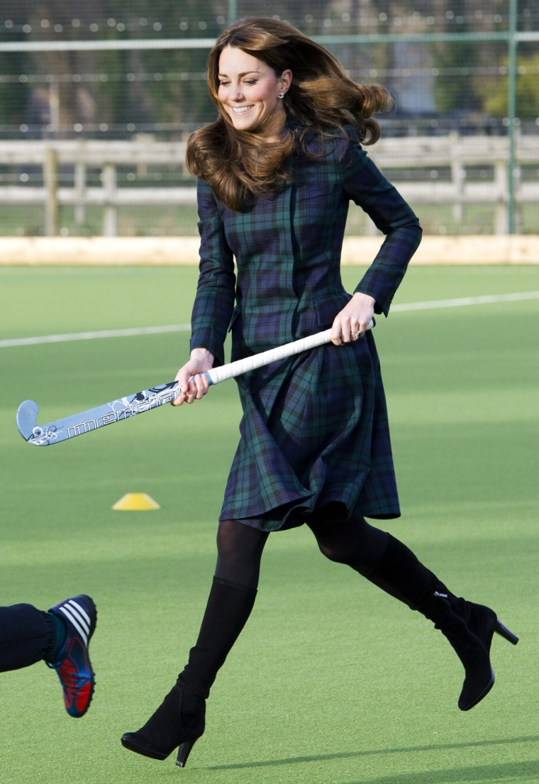 Kate Middleton, the Duchess of Cambridge, plays hockey during her visit to St. Andrew's School in Pangbourne, England, Nov. 30, 2012.