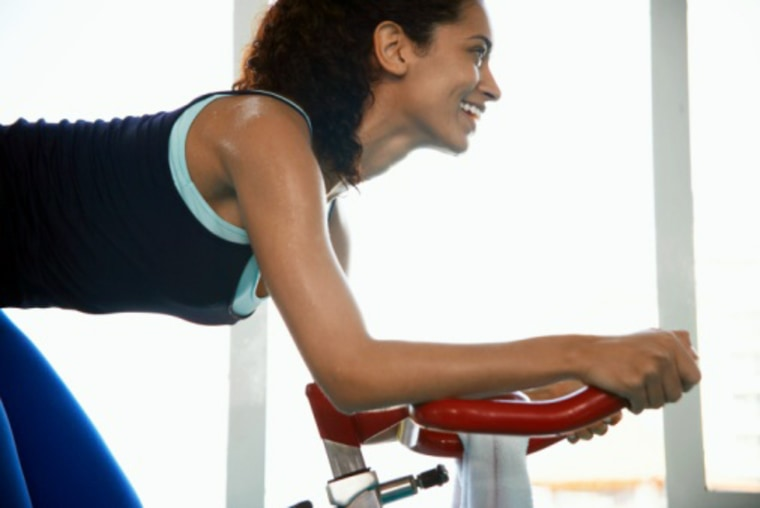 Young woman indoor cycling, sweat, sweating, exercise, fitness, gym, bike, bicycle, smile, msnbc stock photography, getty images, photodisc, Top, Health and Healthcare, Enjoyment, Endurance, Healthcare And Medicine, Sport, Horizontal, Waist Up, Indoors, 20-24 Years, Back Lit, Side View, Profile, Long Hair, Black Hair, Caucasian Appearance, African-American Ethnicity, Mixed Race Person, Cycling, Window, Leaning, Smiling, Gym, Day, Sweat, One Person, Healthy Lifestyle, Exercising, Exercise Bike, Color Image, Bending Over, Sports Clothing, Young Women, One Young Woman Only, Only Women, One Woman Only, Leisure Activity, Photography.