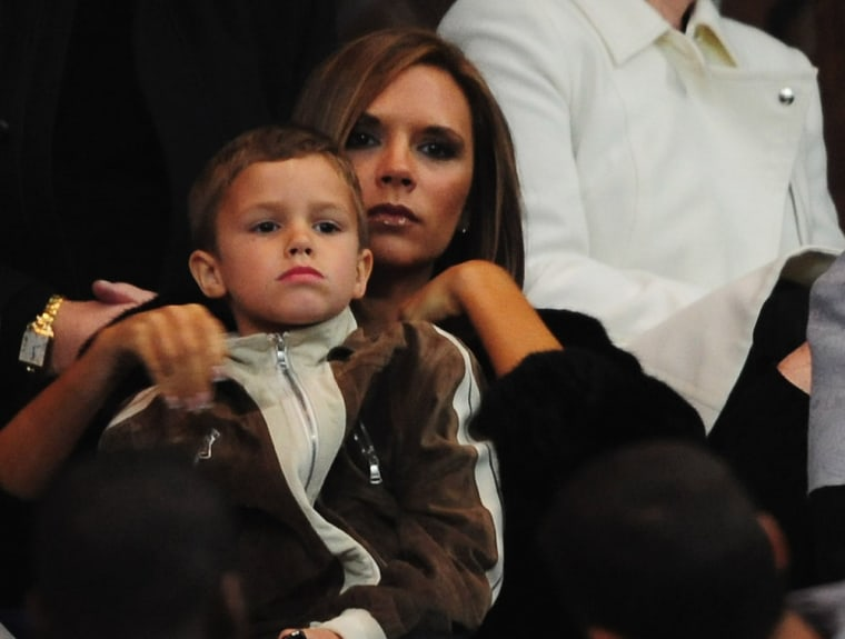 Runs in the family: Victoria Beckham embraces son Romeo on March 26, 2008 in Paris, France.