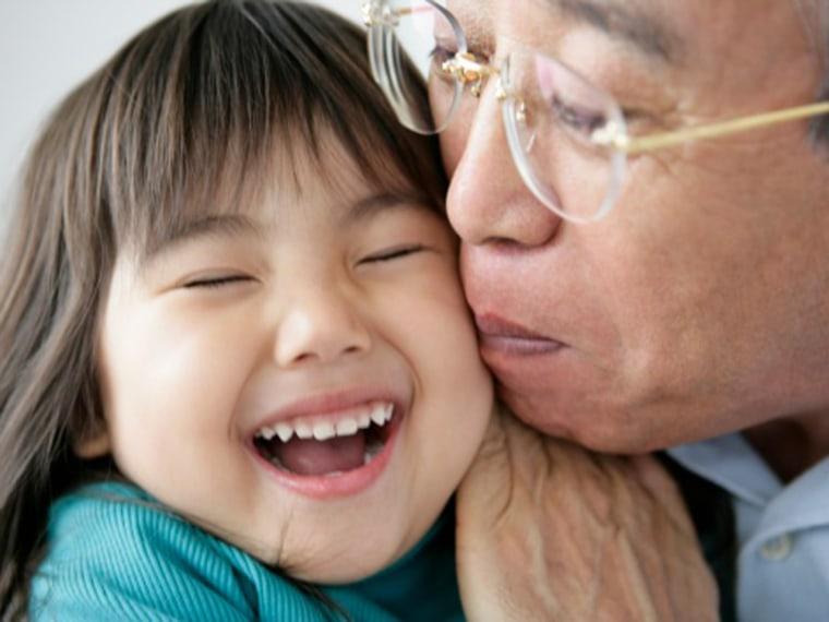 Grandfather kissing granddaughter, close-up