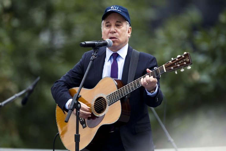 """Paul Simon is seen performing """"Sound of Silence"""" during the 10th anniversary commemoration of the attacks on America at Ground Zero in New York on Sept. 11, 2011. He performed the same song at Victoria Soto's funeral."""