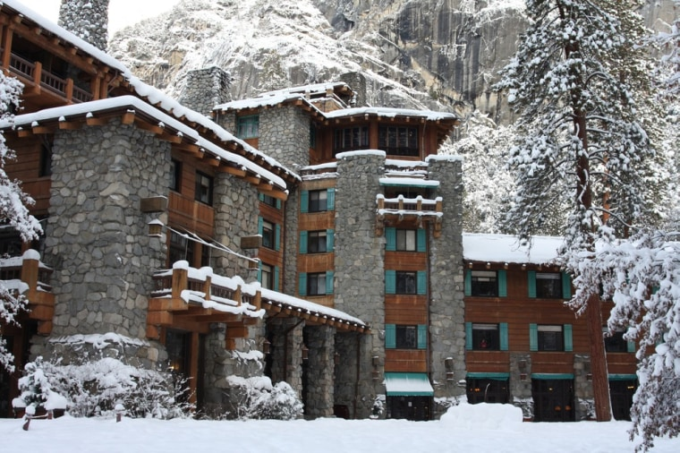the ahwahnee at yosemite national park features a lounge with 24 foot high ceilings and a massive stone fireplace where guests can drink hot cocoa - The Christmas Lodge