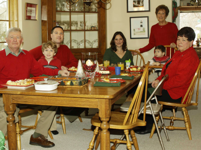 The Parker family of Pontiac, Mich., is shown on Christmas Day 2010, minutes before the clear glass baking dish at the head of the table shattered into hundreds of shards, according to Debbie Parker. Parker, standing, said she found glass pieces three feet away under the Christmas tree.