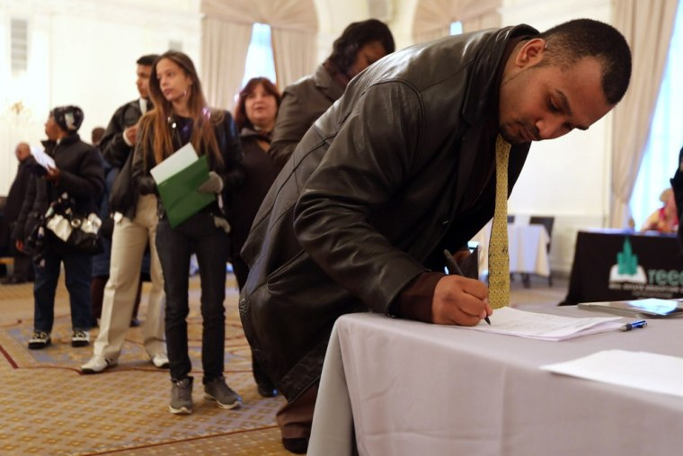 Applicants register before meeting potential employers at the Diversity Job Fair on December 6, 2012 in Manhattan, New York City. Jobless claims fell ...