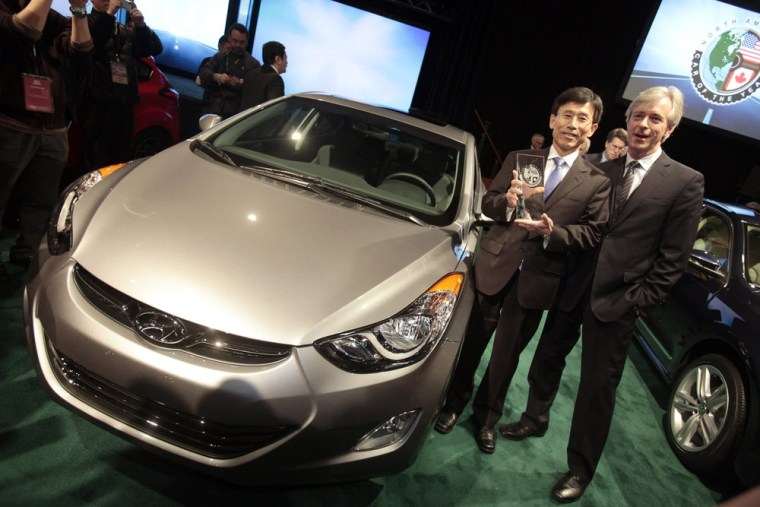 H.W. Park, Hyundai managing director and chief executive, and Hyundai Motor America CEO John Krafcik are seen after the Hyundai Elantra was awarded the 2012 North American Car of the Year award at the 2012 North American International Auto Show on Jan. 9 in Detroit.