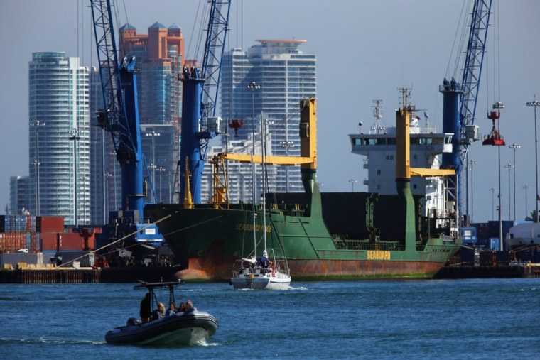 A container ship is docked at the Port of Miami on Thursday in Miami, Fla.