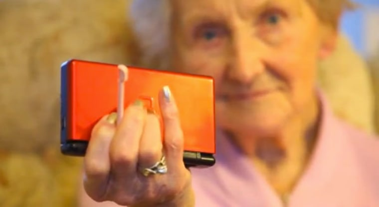 Kathleen Connell shown with her Nintendo DS portable game system