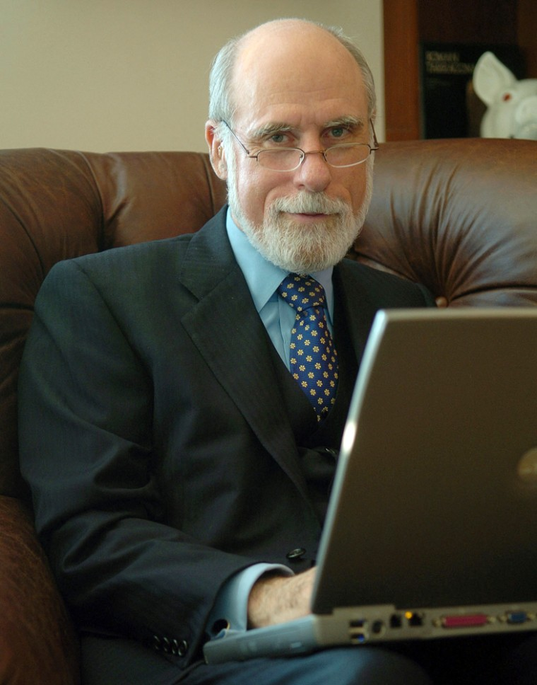 ** FILE ** Vinton Cerf works on his computer in his McLean, Va., home in a file photo from Sept. 6, 2005. On the Internet, the traffic cops are blind, they don't look at the data they're directing, and they don't give preferential treatment. That's something operators of the Internet highway, the major U.S. phone companies, are looking at changing. They want to be able to give priority treatment to those who pay for their traffic to get through faster, in effect adding a toll lane. (AP Photo/Kevin Wolf, File)