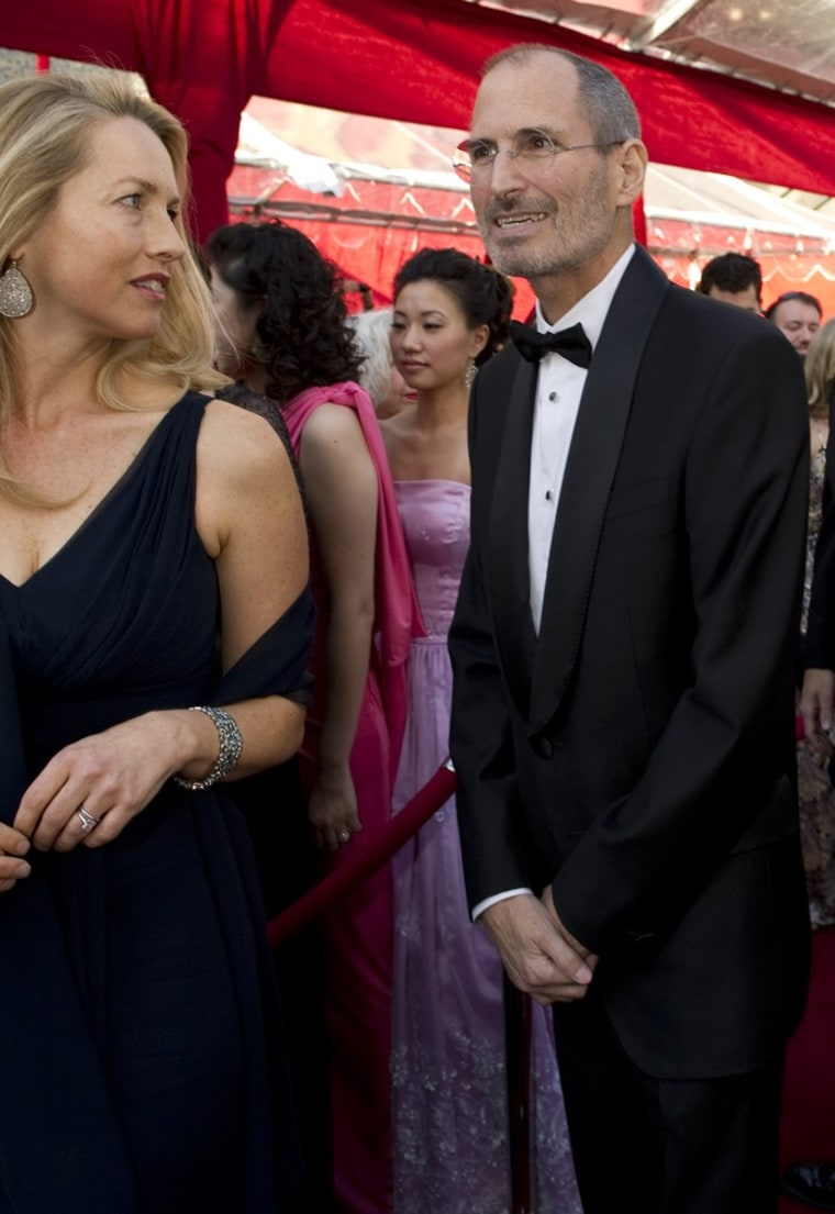 REFILE - REMOVING THIRD PARTY DISCLAIMER Apple's Steve Jobs and wife Laurene Powell (L) go through the security tent as they arrive at the 82nd Annual Academy Awards held at Kodak Theatre March 7, 2010 in Hollywood, California, in this handout photograph released to Reuters October 6, 2011 by the Academy of Motion Picture Arts & Sciences. Jobs died October 5, 2011. REUTERS/ Richard Harbaugh/©A.M.P.A.S../Handout (UNITED STATES - Tags: OBITUARY CRIME LAW SCIENCE TECHNOLOGY) NO SALES NO ARCHIVES FOR EDITORIAL USE ONLY. NOT FOR SALE FOR MARKETING OR ADVERTISING CAMPAIGNS