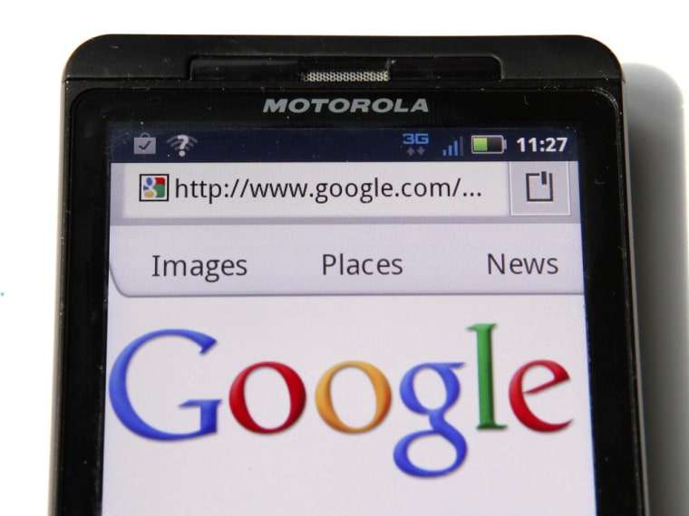 A Google homepage is displayed on a Motorola Droid phone in Washington August 15, 2011. Google Inc will buy phone hardware maker Motorola Mobility Holdings Inc for $12.5 billion to bolster adoption of its Android mobile software, and compete with smartphone rival Apple Inc. In its biggest deal to date, Google said it would pay $40 per share in cash, a 63 percent premium to Motorola Mobility's Friday closing price on the New York Stock Exchange. REUTERS/Kevin Lamarque (UNITED STATES - Tags: SCI TECH BUSINESS)