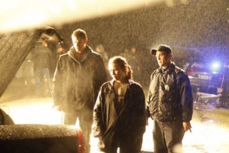 From left to right: Dude Cop, Lady Cop, Some Other Guy (Seriously, does no one in Seattle own an umbrella? )