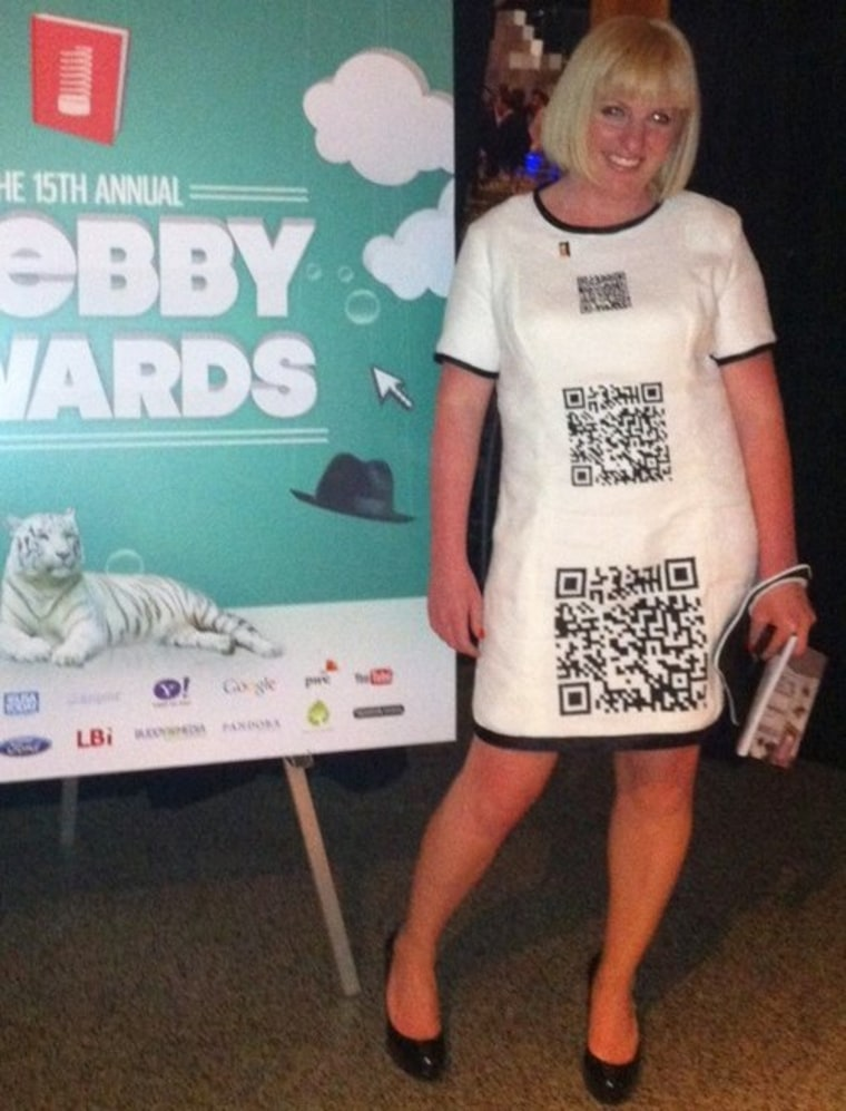 In this photo, shown on Mashable.com, Jessica Stuart wears a QR dress. Scan the codes with a smartphone, and you can see her Webby Award-winning video.