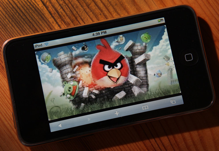 """SAN ANSELMO, CA - MARCH 18:  An image of the popular video game \""""Angry Birds\"""" is displayed on an iPod Touch on March 18, 2011 in San Anselmo, Californ..."""