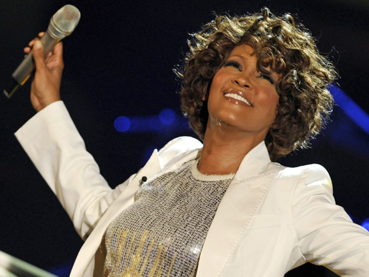 """US singer Whitney Houston performs on stage during the 183rd edition of the TV show presented by  \""""Wetten, dass..?\"""" (Let's Make a Bet) on October 3, 2009 in Freiburg, southern Germany.          AFP PHOTO   DDP/ JOERG KOCH          GERMANY OUT (Photo credit should read JOERG KOCH/AFP/Getty Images)"""