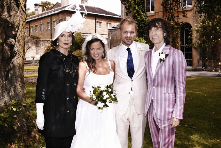 Jade Jagger, second from left, daughter of Rolling Stones frontman Mick Jagger, right, and his ex-wife Bianca, left, poses with her new husband Adrian Fillary after their wedding at Aynhoe Park, Oxfordshire, on June 30.