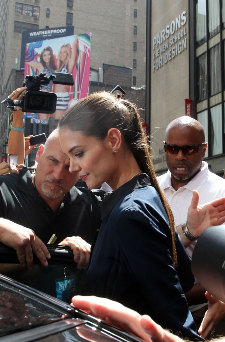 """Photographers surround Katie Holmes outside of Parsons The New School of Design, where """"Project Runway"""" is filmed."""