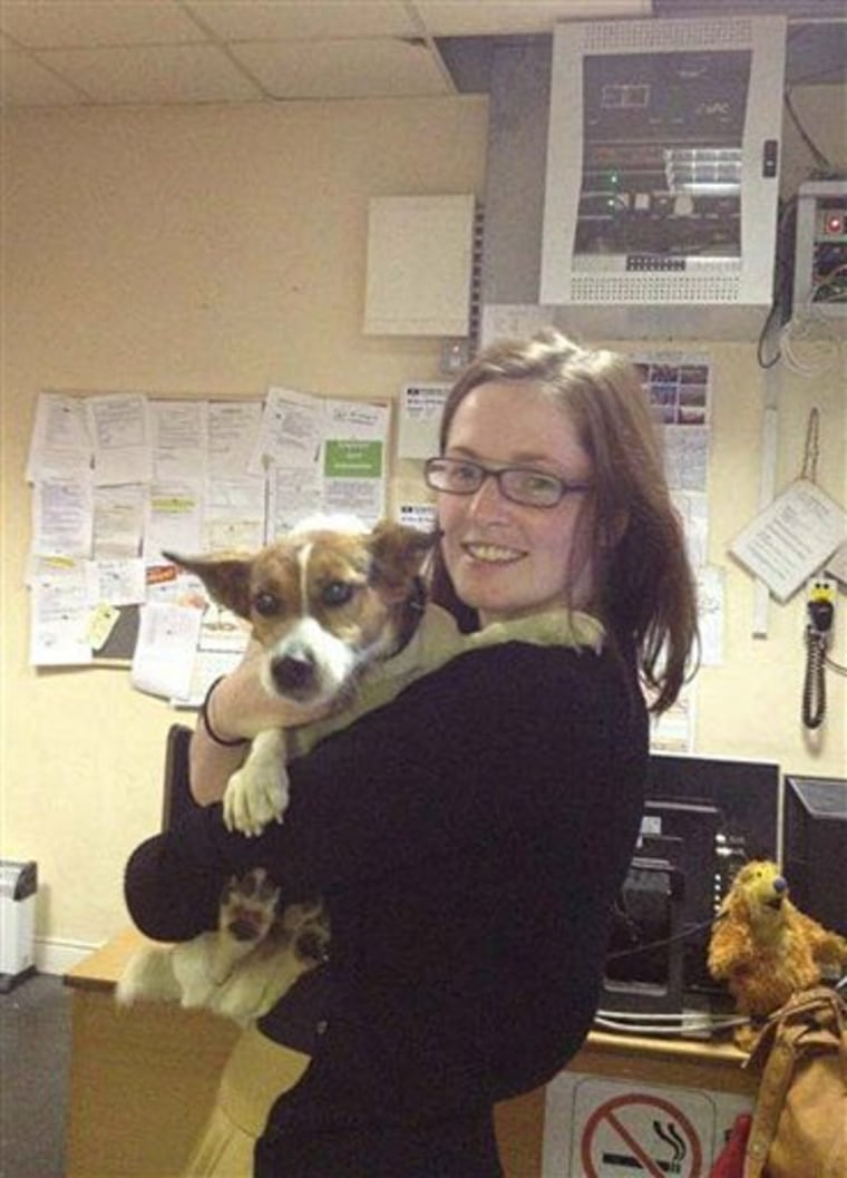 Deirdre Anglin is reunited with her Jack Russell terrier Patch Wednesday July 4, 2012 in Dublin, Ireland.