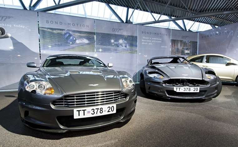 """The Aston Martin DBS 2007 and Aston Martin Stunt Car from """"Casino Royale"""" are on display at the National Motor Museum in Beaulieu, as part of the """"Bond in Motion"""" exhibit."""