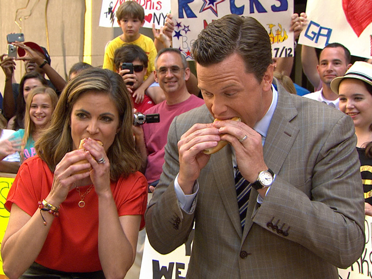 Natalie and Willie throw down some dogs, sans the water real competitive eaters get.