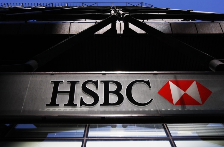 A HSBC bank logo is highlighted by the sun in London in this file photo taken March 1, 2010.