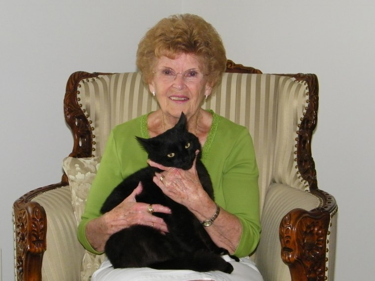 Barbara Oliphant snuggles with Wollie, who walked six miles over three days to get home.
