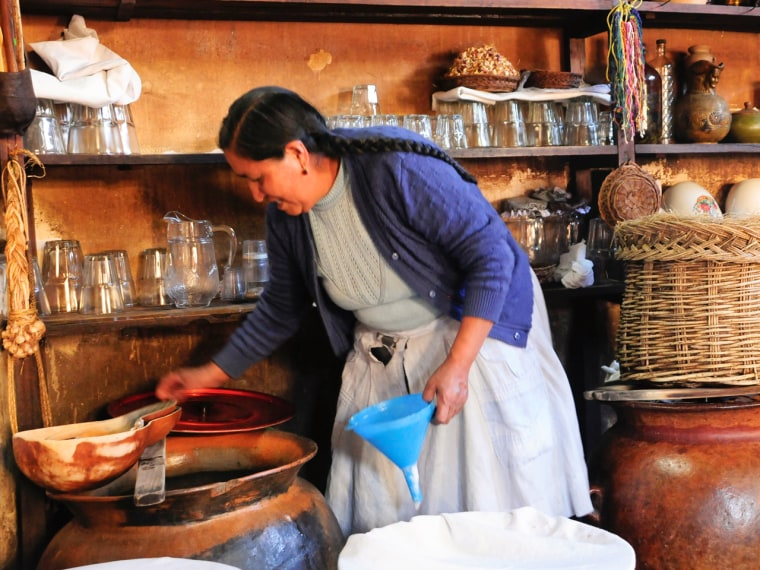A Peruvian woman prepares chicha, a fermented drink made of corn that inspired Eric Ripert on a recent trip.